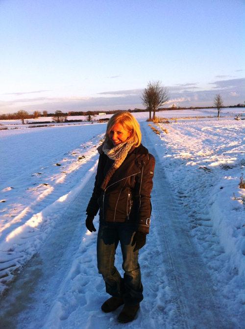Hilary Robinson walking in a snowy landscape