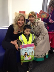 Hilary Robinson with Naila and her son Musa, at the City Library in Bradford.